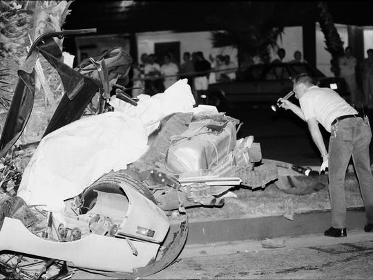 Police study the scene of a pursuit crash that claimed two lives on May 19, 1992. Mark Castleman and Chad Tigner, two AWOL soldiers, were killed.