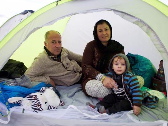 Nikolia Apostolou for usa todayZakhir Nair, 40, an Afghan refugee, waits with his wife and their 14-month-old son at the Greek-Macedonian border. Zakhir Nair, 40, an Afghan refugee with his wife and 14-month-old son, are waiting at a camp in Idomeni, Greece, at the Greek-Macedonian border so they can cross and move on into Germany.