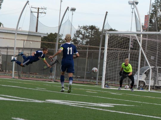 COS sophomore Daniel Villareal, a Delano High grad, heads in a goal against Folsom Lake College.