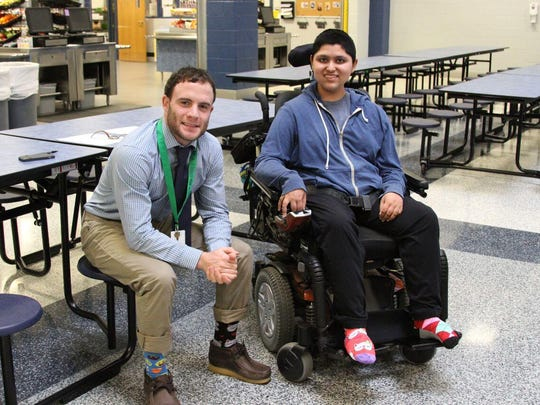 St. Georges para-educator John Archangelo, left, and student Arun Singh '19 rock their socks for down syndrome awareness March 21.