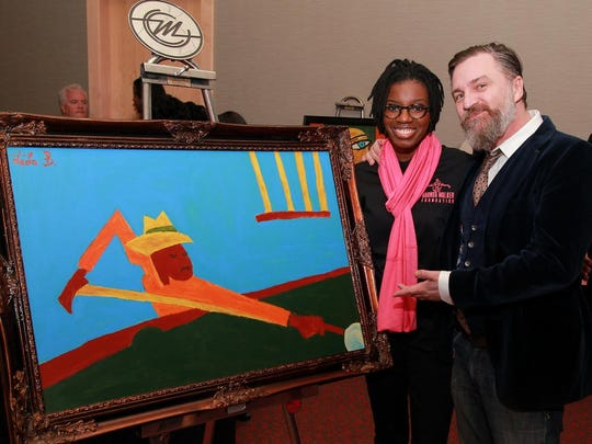 Student Le'La Barnes and artist Tony Roko show off