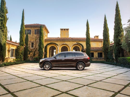 2016 Buick Enclave Tuscan edition, a distinctive expression of General Motors Co.'s popular crossover, highlighted by a bronze-tone grille and 20-inch chrome-clad wheels with bronze accents.