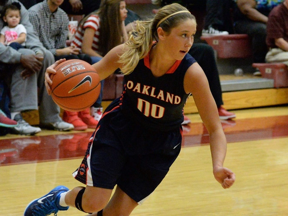Oakland guard Ansley Eubank (00) drives to the basket against Riverdale during the District 7-AAA tournament at Riverdale Saturday night.
