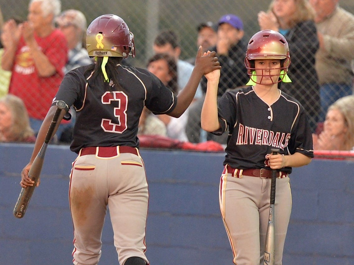 Alexis Castleman (3) gets congratulated by Brooklyn Pendergrast after scoring a run against Oakland on Tuesday.