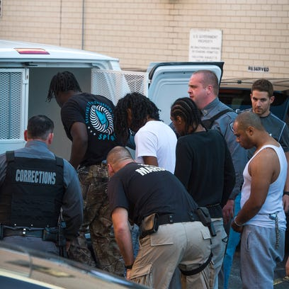 Defendants are taken from federal court Nov. 17 after