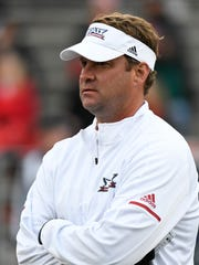 Florida Atlantic Owls head coach Lane Kiffin watches
