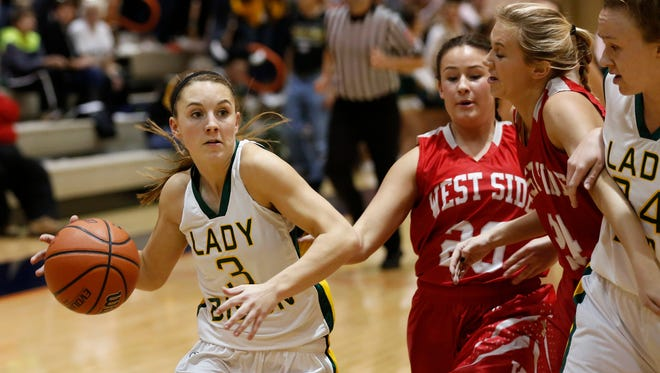 Benton Central's Bayley Goodman drives to the basket against West Lafayette in the semifinals of the J&C Hoops Classic Thursday, November 19, 2015, at Harrison. Goodman led all scorers with 26 points as Benton Central defeated West Lafayette 58-43 and will face Central Catholic in the championship Saturday.
