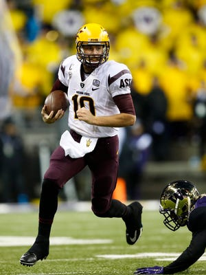 Arizona State Sun Devils quarterback Taylor Kelly (10) scrambles out of the pocket against the Washington Huskies during the first quarter at Husky Stadium.