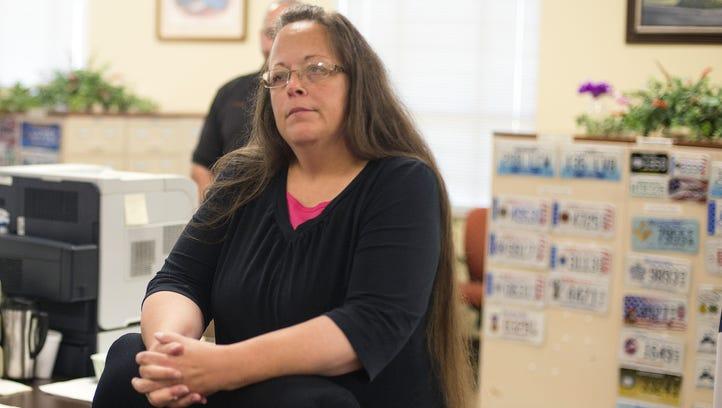 Rowan County Clerk Kim Davis listens to Robbie Blankenship