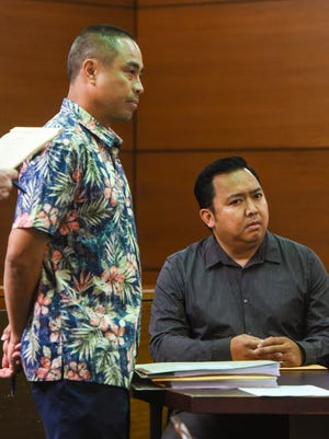 Prestige Auto Sales Manager Orlando Domingo, seated, appears in the Superior Court of Guam with his attorney on Tuesday, Jan. 17, 2017.
