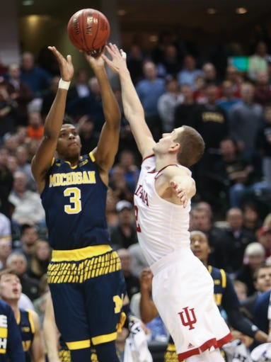 Michigan's Kameron Chatman hits the game-winning three