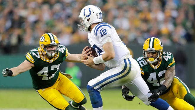 Green Bay Packers' Jake Ryan and Morgan Burnett chase down Indianapolis Colts' Andrew Luck as the Green Bay Packers host the Indianapolis Colts on Sunday, November 6, 2016, at Lambeau Field in Green Bay, Wis.