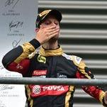 Romain Grosjean celebrates on the podium after finishing third at the Belgian Grand Prix.