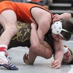 Jackson Renicker won both of his matches on Wednesday night against Grand Blanc and Howell.