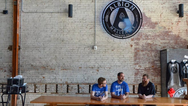 John Rogers (left), Ben Wade and Charles Moreau first came together on the project in October 2015. On Monday, May 21, Albion Malleable Brewing Company opened its doors for its grand opening.