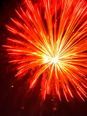 A burst of fireworks lights up the sky in Dearborn.
