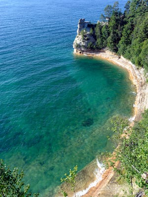 The rock formation at Miners Castle stands out in Lake Superior at Pictured Rocks National Lakeshore near Munising.
