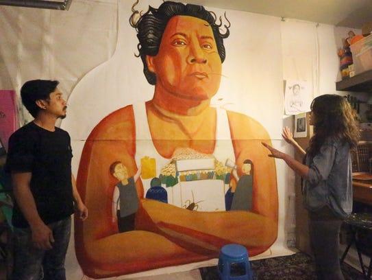 Artists Ramon Cardenas, left, and Christian Cardenas
