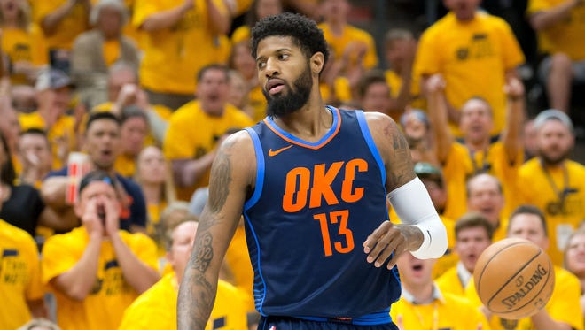 Oklahoma City Thunder forward Paul George (13) between plays during the first half of game six of the first round of the 2018 NBA Playoffs against the Utah Jazz at Vivint Smart Home Arena.