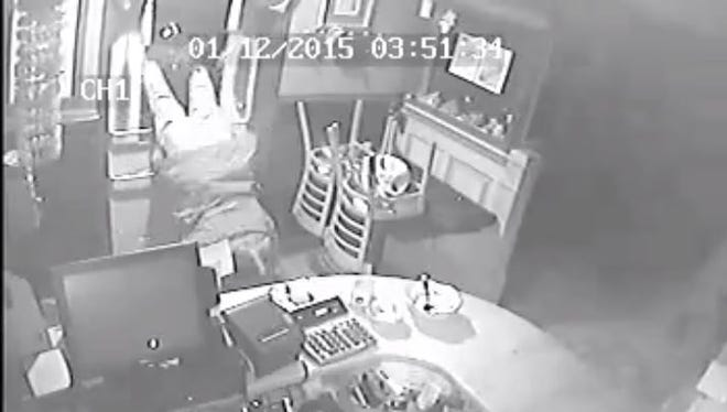 Surveillance footage from Jan. 12 shows one unidentified man breaking into Mai Thai.