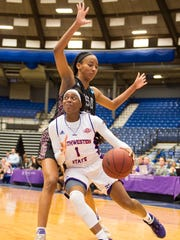 Northwestern State's Gabby Bell (1) drives past Texas Southern's Isis Lane during Saturday's game.
