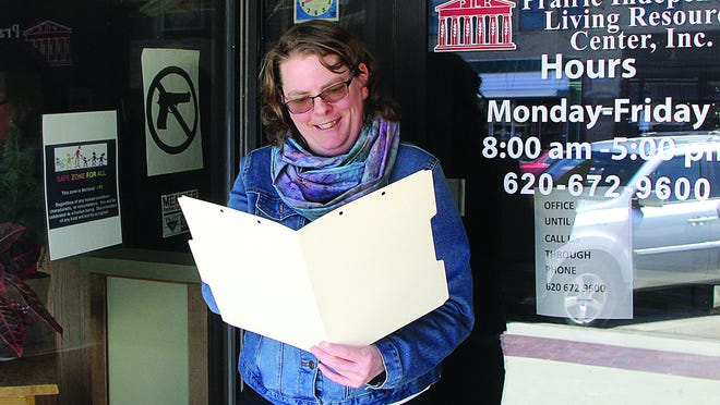 Independent Living Specialist Chelsey Rose checks a file outside the Prairie Independent Living Resource Center in Pratt. Walk-in assistance at the PILR office has been discontinued because of  COVID-19 response guidelines, but Rose and her co-workers continue to assist consumers over the phone, online or with emails.