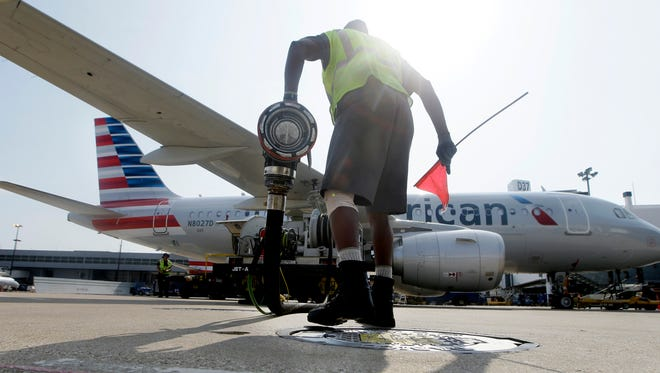 Scott Mills finishes fueling up an American Airlines jet at Dallas/Fort Worth International Airport in Grapevine, Texas.