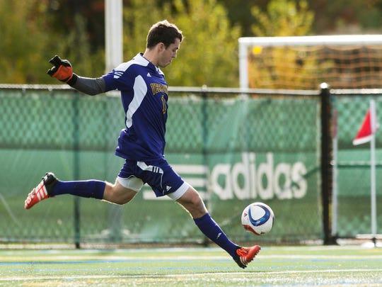 Vermont goalie Greg Walton (1) kicks the ball down