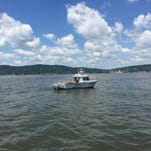The Rockland sheriff's marine unit patrols the Tappan Zee Bridge construction site in June. The department is getting nearly $250,000 in federal funding for a new boat.