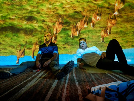 "This image released by TriStar Pictures shows Jonny Lee Miller, left, and Ewan McGregor in a scene from ""T2: Trainspotting."" (Jaap Buitendijk/Sony- TriStar Pictures via AP)"