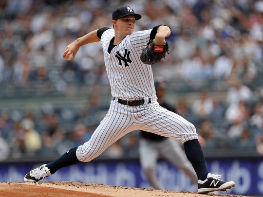 New York Yankees starting pitcher Sonny Gray pitches against the Cleveland Indians during the third inning at Yankee Stadium.