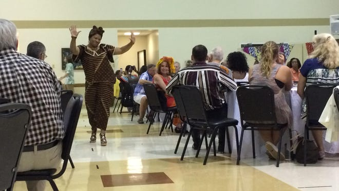 Annette Holt dances during the fashion show at 'A Taste of Congo' Saturday at West Jackson Baptist Church.