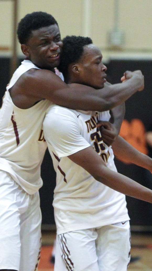Mount Vernon's Gregory Calixte, left, and  Jayquan Smith celebrate after beating Pine Bush 68-59 in a Class AA state regional semifinal with Pine Bush at White Plains March 7, 2017.