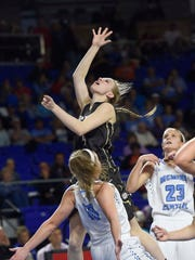 Upper man's Brooke Farris (4) charges over Central's Jacobi Lynn (10) during the Class AA semifinals Friday at MTSU.