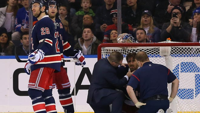New York Rangers goalie Henrik Lundqvist was hit in the neck by a puck in late January.