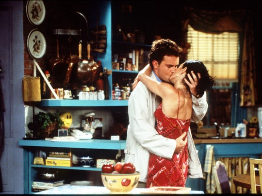 Matthew Perry and Courteney Cox in a scene from 'Friends'