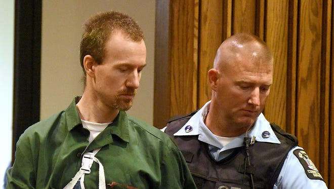 David Sweat, left, is led into Clinton County Court on Thursday, Aug. 20, 2015, in Plattsburgh, N.Y. Sweat, a convicted killer who escaped June 6 from the Clinton Correctional Facility and spent more than three weeks on the run, was arraigned Thursday on criminal charges stemming from the breakout. Sweat pleaded not guilty to first-degree escape and promoting prison contraband.