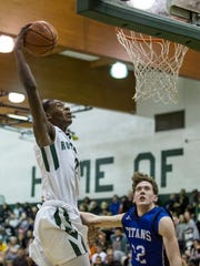 New Haven's Eric Williams dunks the ball during a basketball