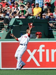 Mookie Betts (50) makes a catch for an out during the