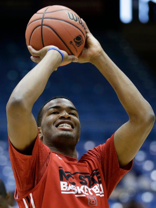 North Carolina State forward T.J. Warren shoots during practice for an NCAA college basketball tournament game, Monday, March 17, 2014, in Dayton, Ohio. NC State plays Xavier on Tuesday in a first round game. (AP Photo/Al Behrman)