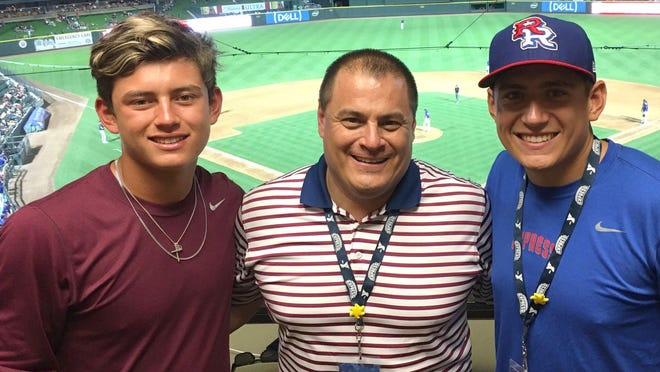 Chase Almendarez, right, pauses during a Round Rock Express game with brother Luke, left, and father Chris in 2018. Chase Almendarez, the manager of baseball operations for the Express and a former player for Round Rock High School, will be the manager for the Hairy Men of the Texas Collegiate League this summer.