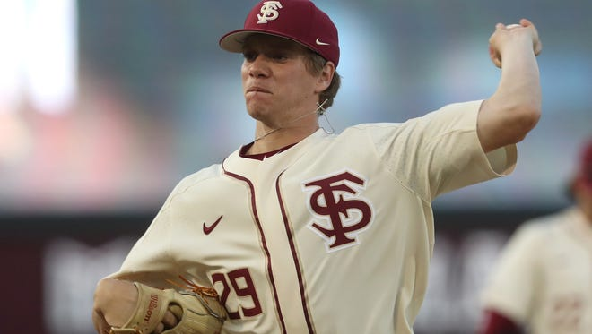 FSU's Austin Pollock pitches against Duke during their game at Dick Howser Stadium on Friday, April 13, 2018.