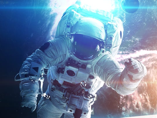Astronaut in outer space. Elements of this image furnished by