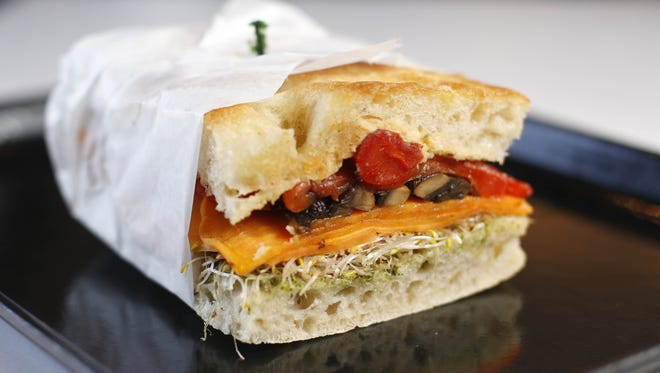 The veggie sandwich features portobello, sweet potato, red pepper, hummus, pesto and sprouts at La Mie Express in downtown Des Moines.