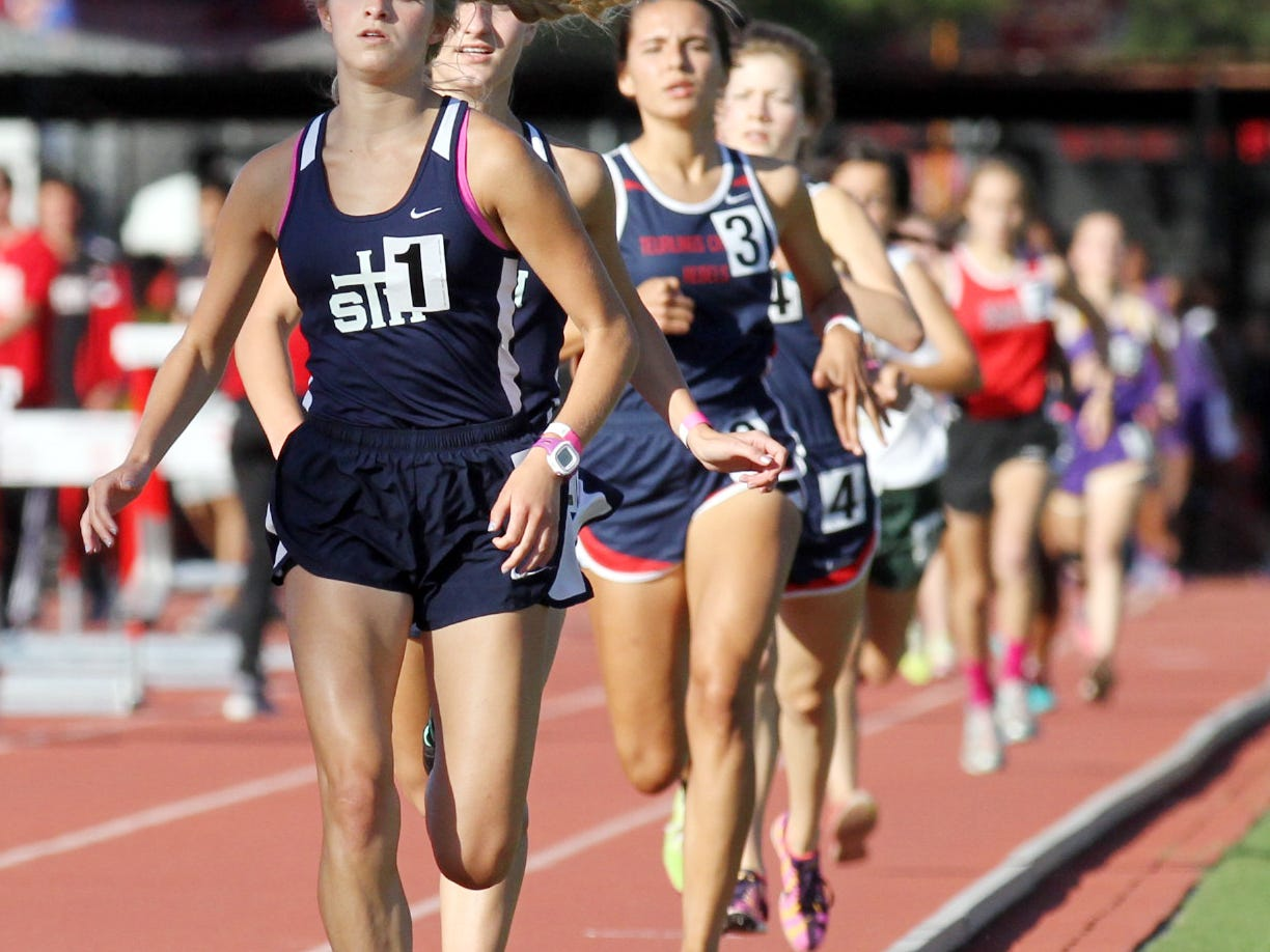 St. Thomas More's Hannah Bourque leads in the 1600m race during the Class 4A regional Wednesday at UL's Cajun Track Complex.
