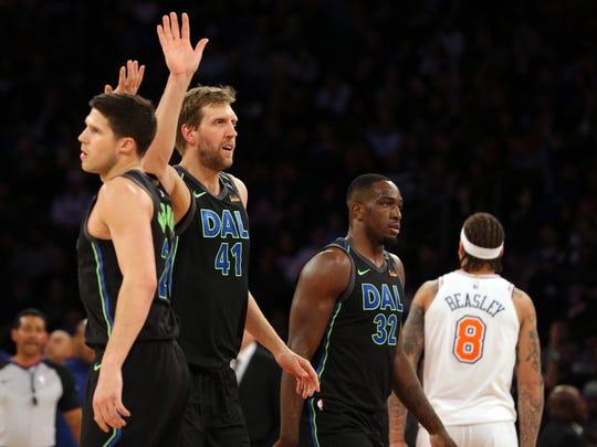 Dallas Mavericks center Dirk Nowitzki (41) high fives Dallas Mavericks small forward Doug McDermott (20) after a three point shot against the New York Knicks during the fourth quarter at Madison Square Garden.