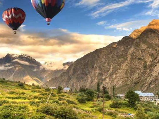 hot air balloons flying near mountains in New Mexico