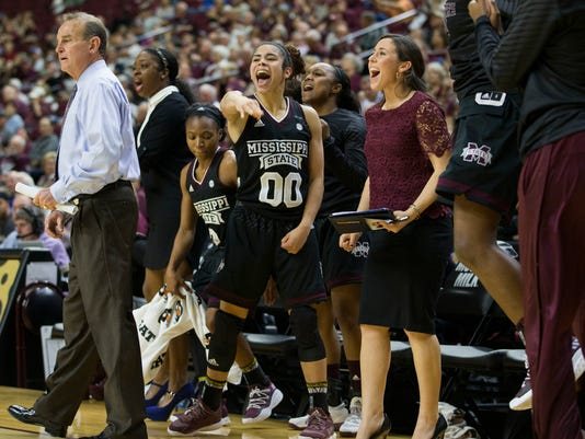 Mississippi State guard Dominique Dillingham (00) and the rest of the Mississippi State bench reacts as a teammate scores a basket late in a NCAA college basketball game against Texas A&M, Sunday, Feb. 19, 2017, in College Station, Texas. (AP Photo/Sam Craft)