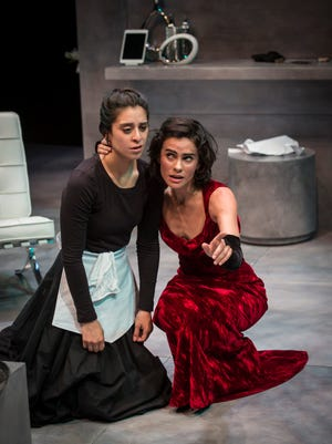 """While their employer is away, sisters Andrea San Miguel (left) and Melisa Pereyra fantasize about being her, and about killing her, in """"The Maids,"""" performed by American Players Theatre in Spring Green."""