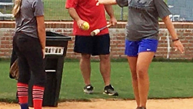 ECHS softball coach Jane Trzaska, right, continues to work hard in her second year.